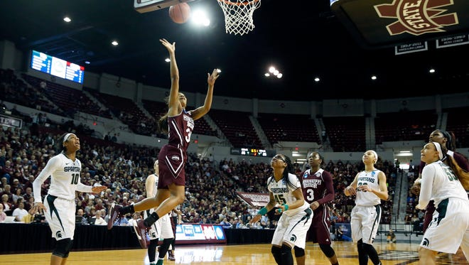 Mississippi State forward Victoria Vivians (35) shoots a layup past Michigan State defenders during the first half in a second-round women's college basketball game in the NCAA Tournament, Sunday, March 20, 2016, in Starkville, Miss. (AP Photo/Rogelio V. Solis)