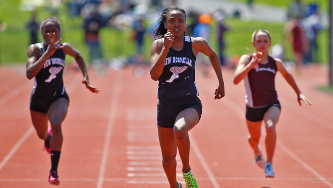 New Rochelle's Symone Darius wins the 100-meter dash with a 12.04 time at the Westchester County Track and Field Championships at Byram Hills High School in Armonk on Sunday, May 18, 2014.