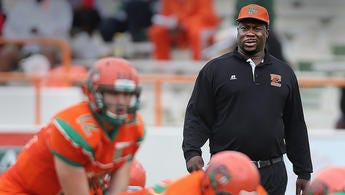 FAMU coach Earl Holmes watches as the offense during Saturday's Orange and Green game.