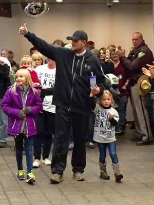 South Dakota Highway Patrol Zachary Bader leaves a Rapid City Hospital on Friday night.