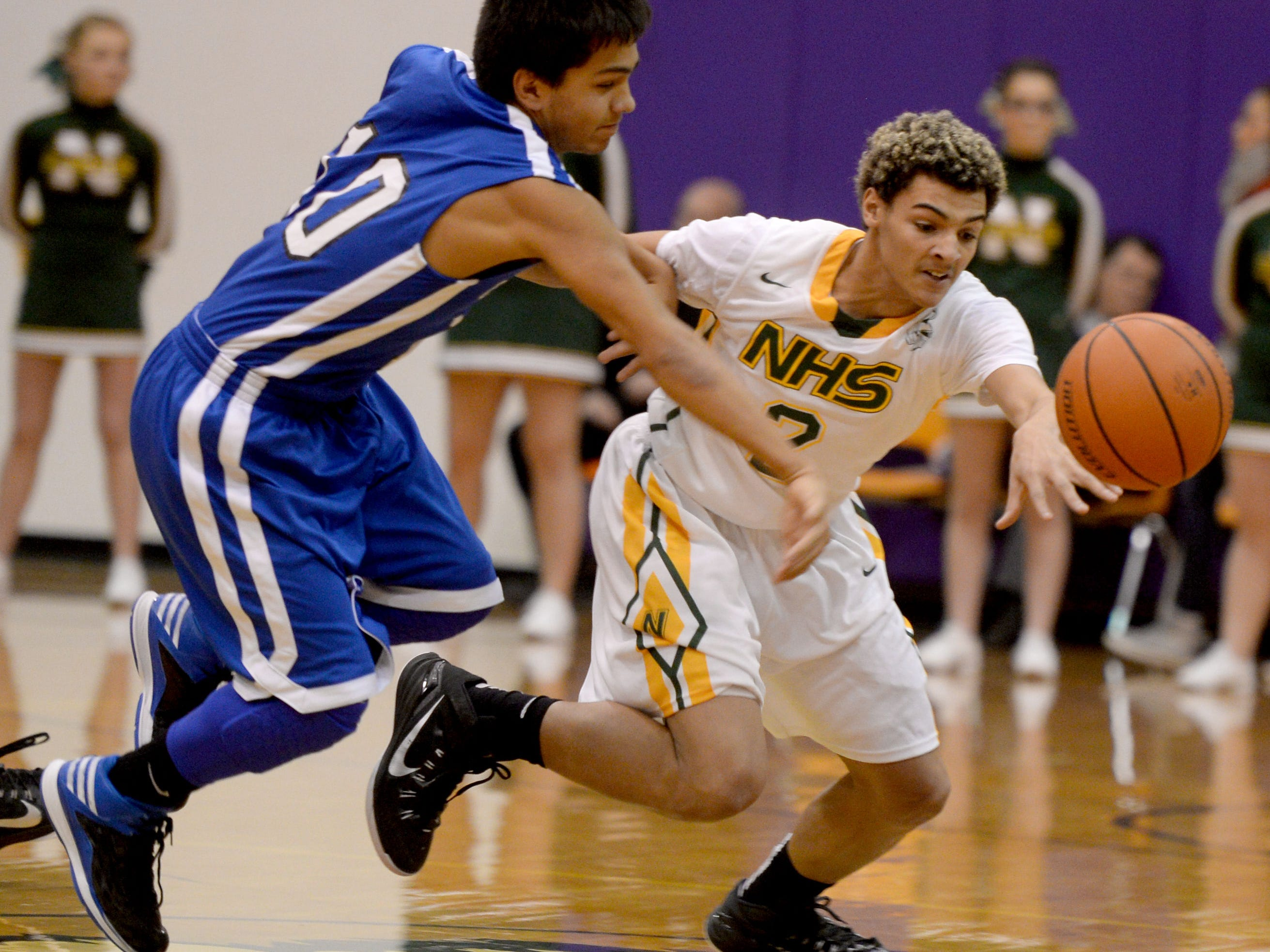 Northeastern's Tyler Smith knocks the ball loose from Centerville's Ricky Torres during the boys basketball championship game of the Wayne County Tournament in Hagerstown Monday.