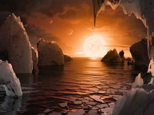 This image provided by NASA/JPL-Caltech shows an artist's conception of what the surface of the exoplanet TRAPPIST-1f may look like, based on available data about its diameter, mass and distances from the host star. The planets circle tightly around a dim dwarf star called Trappist-1, barely the size of Jupiter. Three are in the so-called habitable zone, where liquid water and, possibly life, might exist. The others are right on the doorstep.