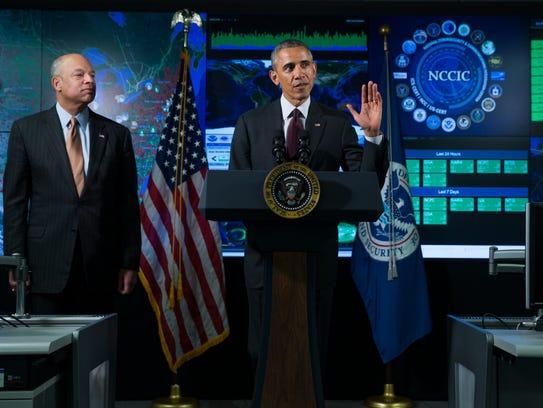 Homeland Security Secretary Jeh Johnson listens at