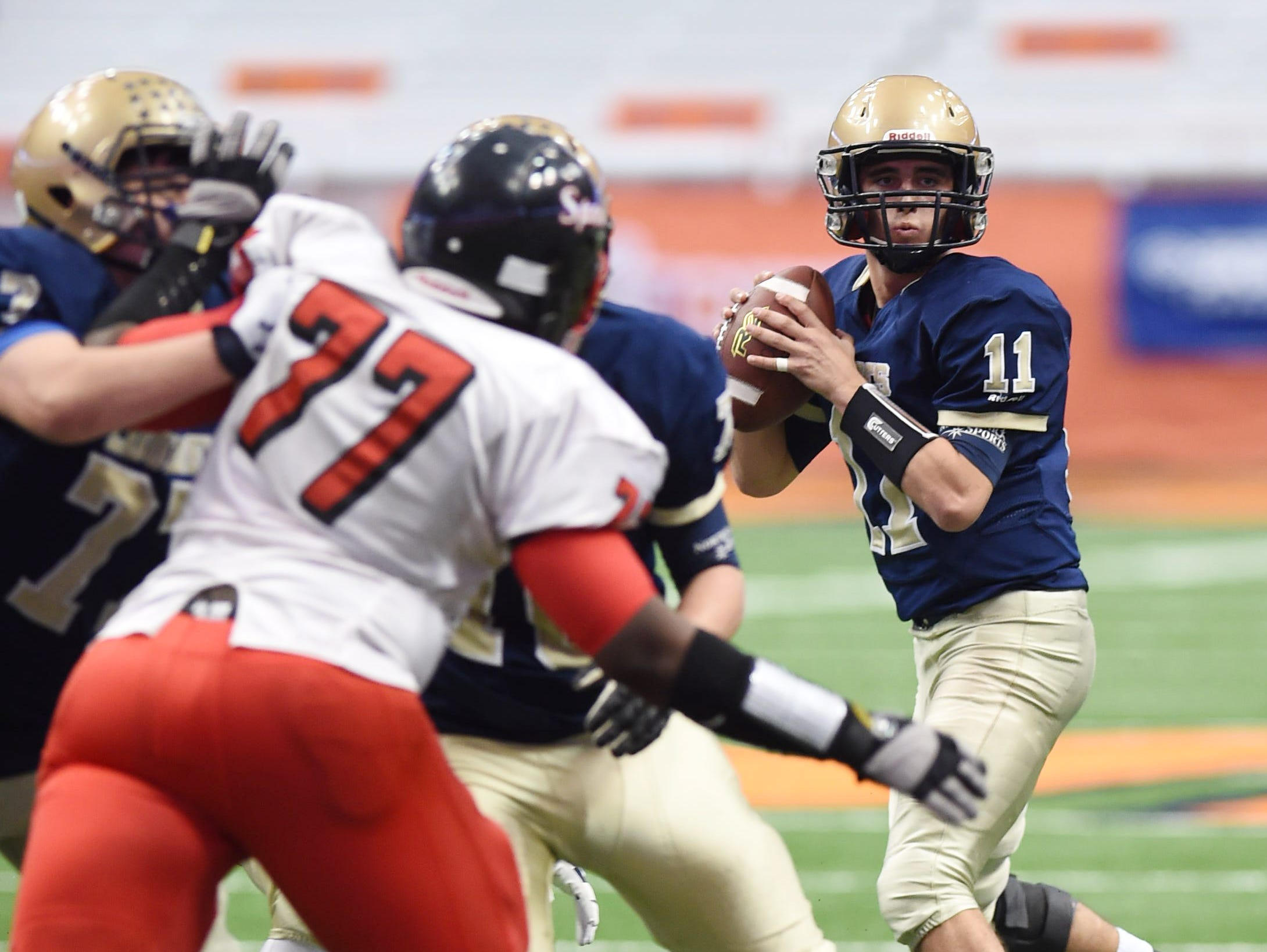 Lourdes' Dean Rotger looks to pass the ball during the New York State Championship final versus South Park in Syracuse on Friday.