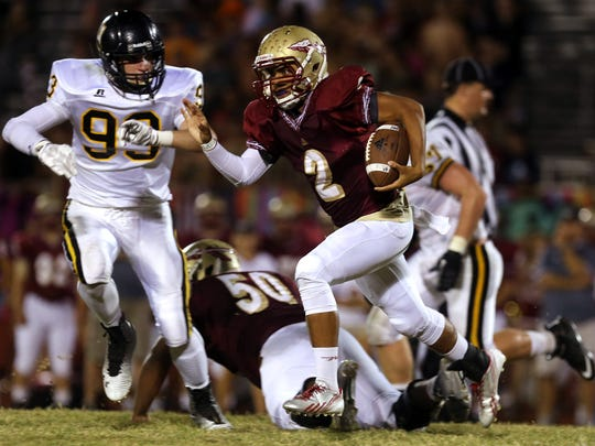 Riverdale quarterback Cortland Owens runs the ball against Hendersonville in the second half Friday, Sept. 26, 2014 at Riverdale.
