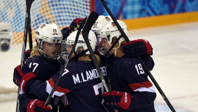 USA forward Monique Lamoureux (7) celebrates with her teammates after scoring a goal against Sweden in a women's ice hockey semifinal during the Sochi 2014 Olympic Winter Games at Shayba Arena.
