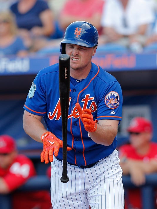 New York Mets' Jay Bruce reacts after striking out in the fourth inning of a spring training baseball game against the St. Louis Cardinals Tuesday, March 28, 2017, in Port St. Lucie, Fla. (AP Photo/John Bazemore)