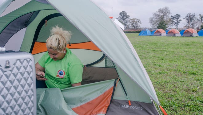Nati Santana, Seminole State freshman from Orlando Fla., unloads her stuff at her tent at the Lowndes Interpretive Center in White Hall, Ala., on Friday, March 20, 2015.