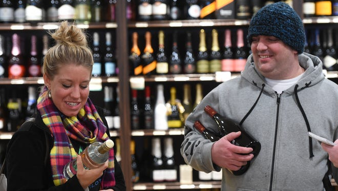 Former co-workers Lindsay Godfrey and Andrew Bowman ran into each other while buying alcohol on Friday. The duo were preparing for the weekend's  snowfall, which could reach between one and 2 feet.