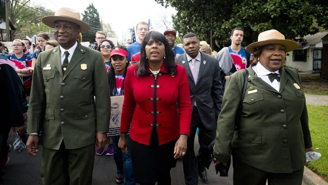 Congresswomen Terri Sewell, center, marches in a commemorative march of the 1965 Selma-to-Montgomery Voting Rights March with others as part of the National Parks Service 50th Anniversary Walking Classroom in Montgomery on March 25, 2015.