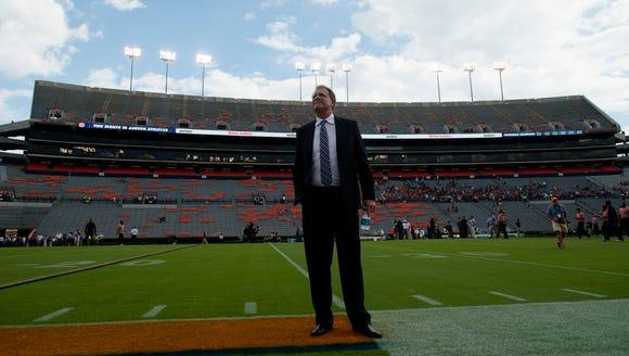 Auburn head coach Gus Malzahn looks on while walking