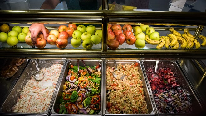 Dishes including couscous, salad and fruit are options for Hanover High School students during lunch.