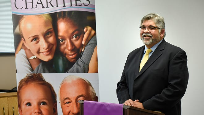 Stephen Pareja speaks during a press conference Friday, Oct. 28, announcing his new position as executive director of Catholic Charities of the Diocese of St. Cloud.