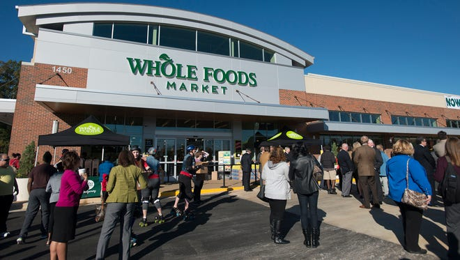 Shoppers wait outside the Montgomery Whole Foods store on Thursday, Nov. 10, 2016, in Montgomery, Ala.