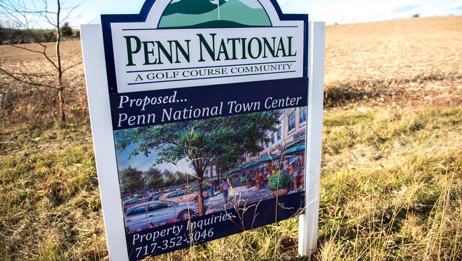 A sign with a rendering of the Penn National town center can be seen on Route 97 near Orchard Rd.