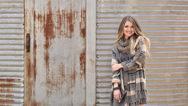 Model: Brooke Miller.Ponchos are the look of the year and this one by Rebecca Elliot ($68) is as beautiful as it is comfortable, topping a grey suede dress by Aryeh ($58.95). Add boots and a scarf for pretty, versatile winter style.