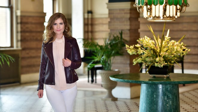 Personal Style Michelle Griffin. Gianni Bini leather jacket, Dillards; JBrand white jeans; blouse, Vintage Find.