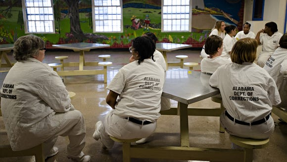 Inmates sit in the visitation area at Tutwiler Women's