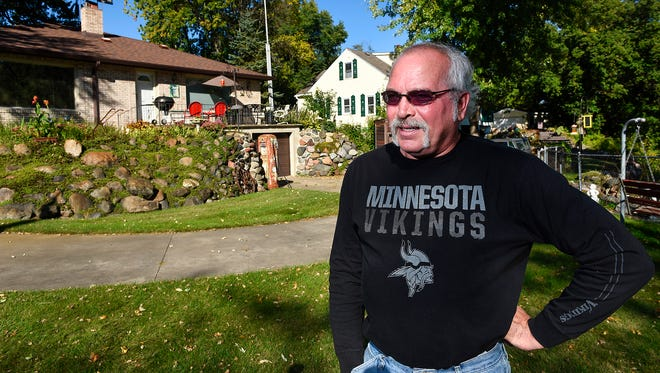 Robert Landwehr and his neighbors have been dealing with the smell from a Sartell sewage lift station for 10 years shown Wednesday, Sept. 20, in his back yard.