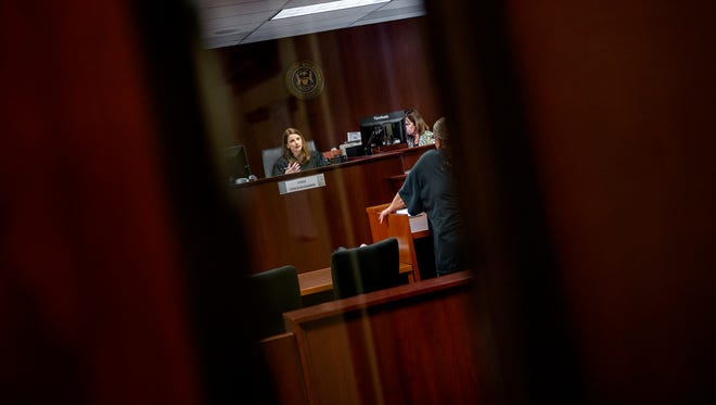 Judge Stacia Buchanan holds an arraignment hearing in her courtroom on Wednesday, Sept. 27, 2017, in Lansing's 54A District Court.