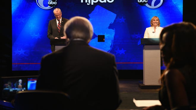 Last-minute preparations are made onstage before the Oct. 10 debate between Democratic candidate Phil Murphy and Republican candidate Kim Guadagno at NJPAC in Newark.