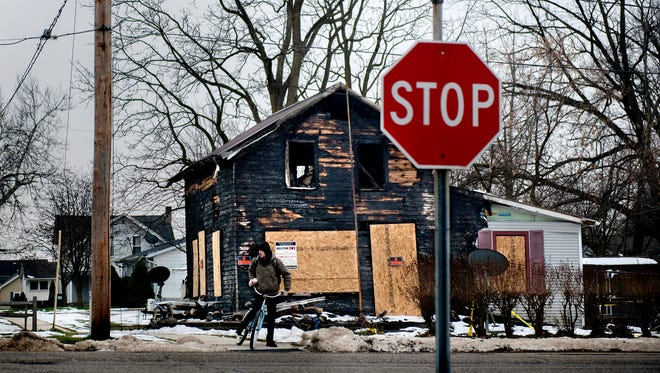 The charred remains of a home on Cottage Street is seen on Friday, December 22, 2017, in Potterville. The house was destroyed in a fire on Nov. 28. The two adults and three children inside the home were able to evacuate prior to firefighters' arrivaland were taken to area hospitals.