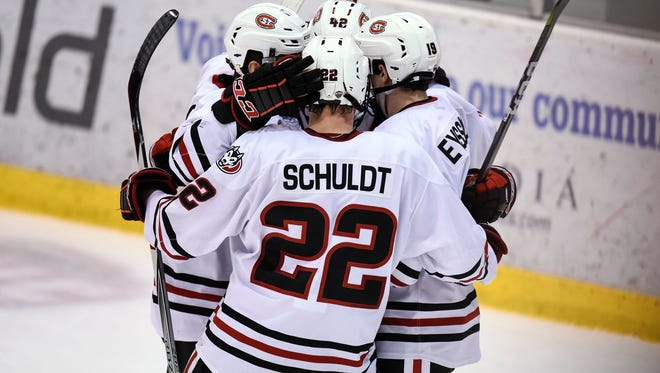 St. Cloud State's Jimmy Schuldt gathers with teammates to celebrate a goal during a game Oct. 21 at the Herb Brooks National Hockey Center in St. Cloud.