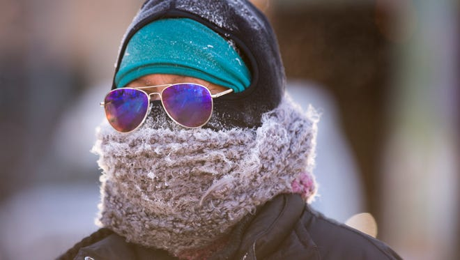 Amber Stewart, Terre Haute, completely covered after finishing the morning's Resolution Run, Indianapolis, Monday, Jan. 1, 2018. Temperatures were about minus 2 degrees Fahrenheit for the start, which drew about 150 people, half of those who registered for the 5 kilometer and 1.5 mile event.