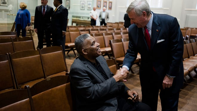 Montgomery School Board chairman Robert Porterfield, left, shakes the hand of Mayor Todd Strange before he spoke during a press conference on Thursday, Jan. 11, 2018, in Montgomery, Ala. The press conference was held to discuss on the state of the Montgomery Public School system.