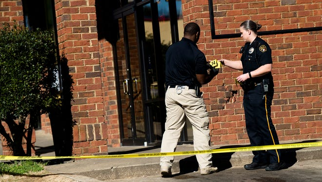Montgomery Police investigate a shooting at King Food Store 409 Hall Street on Monday, Jan. 29, 2018, in Montgomery, Ala.