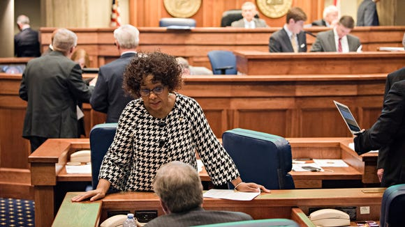 Senator Linda Coleman-Madison, D-Birgmingham, speaks to Senator Tim Melson during the Alabama Legislative session on Thursday, Feb. 15, 2018, in Montgomery, Ala.