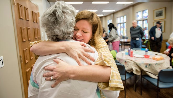 Daphne Johnston, Respite Ministry director, embraces Virginia Harper, a woman suffering from dementia, after she arrives at Respite Ministry on the campus of First United Methodist Church in Montgomery, Ala., in Monday, March 12, 2018.