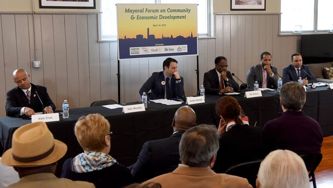 Candidates for Paterson Mayor Alex Cruz, Andre Sayegh, Bill McKoy, Michael Jackson and Pedro Rodriguez answer questions during a Mayoral Forum on Community and Economic Development held at the Great Falls Youth Center on Wednesday, April 18, 2018.