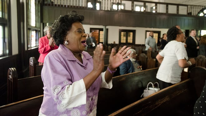 A member of Old Ship A.M.E. Zion Church sings during a Community Service of Remembrance, Restoration and Renewal at Old Ship A.M.E. Zion Church in Montgomery, Ala., on Sunday, April 29, 2018.
