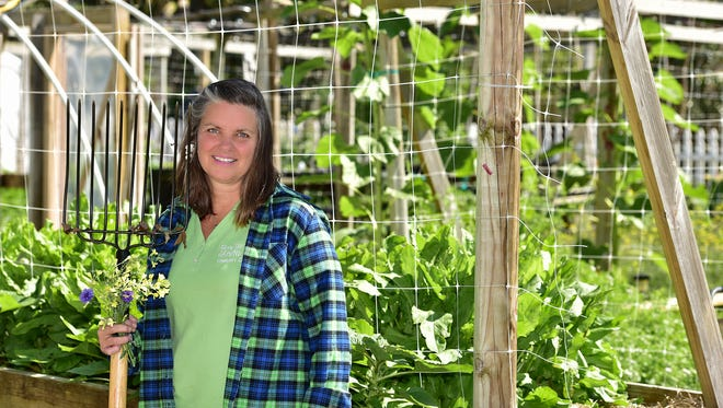 Elizabeth Eubanks manages From the Ground Upcommunity garden in downtown Pensacola. The garden is part of The Hive, which is Innisfree Hotels' corporate social responsibility program.