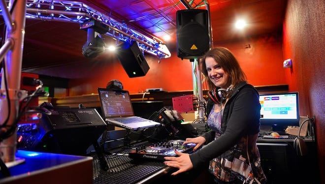 "Danielle ""DJKira"" Kalla enjoys keeping a crowd in a mood to dance in her role as a DJ at the Red Carpet Nightclub and at weddings and parties. She was photographed March 31 at the Red Carpet."
