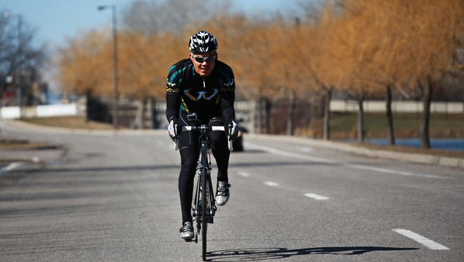 Wayne State University President M. Roy Wilson goes cycling at Belle Isle park in Detroit.