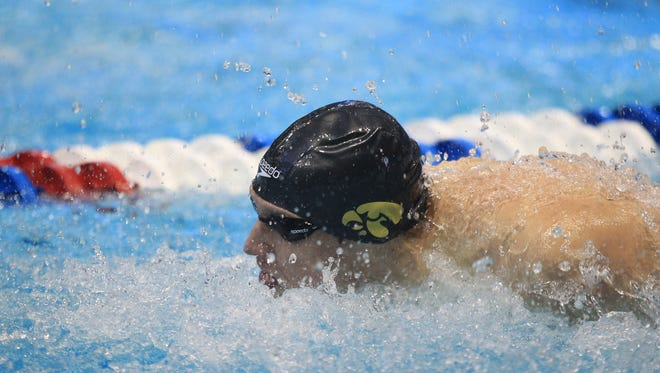 Iowa's Jerzy Twarowski competes in the 400 yard medley relay prelims at the NCAA swimming and diving championships at the Campus Recreation and Wellness Center on Thursday.