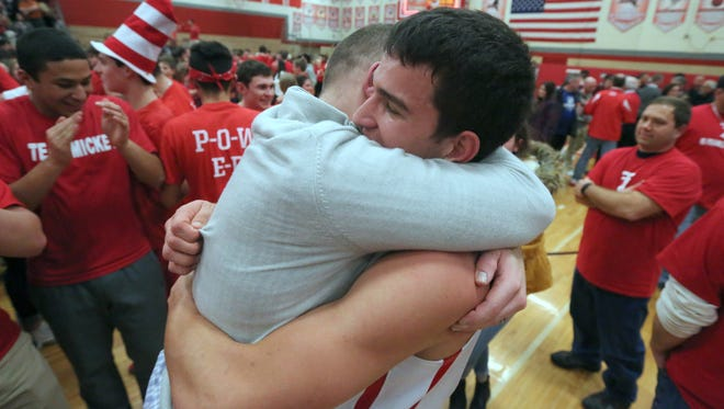 Tappan Zee head coach George Gaines celebrates with Rob McWilliams after TZ beat Harrison 43-42 in a Class A quarterfinal at Tappan Zee Feb. 19, 2016.