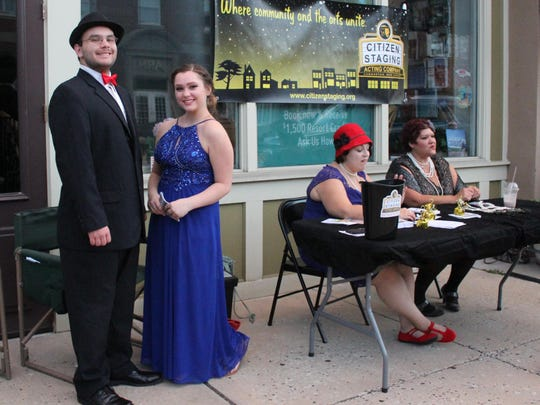 "Actors from the new acting company Citizen Staging sell tickets during a flash sale for their upcoming production ""Eclipse: A Masquerade Murder Mystery."""