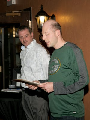 Mike Wahl, president, at left, and Ryan Gebhart, treasurer, present during the first Holyland Food Pantry annual meeting.