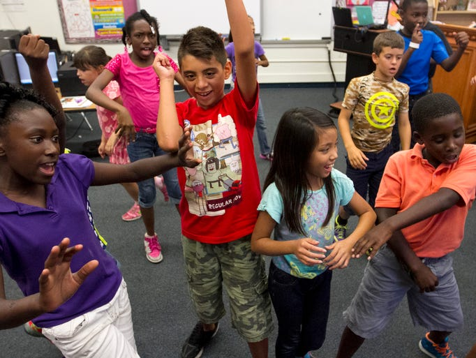 Jessicah Bullock's third grade class has a dance party before being dismissed on the last day of school on Wednesday, May 28, 2014, at Orangewood Elementary School in Fort Myers.