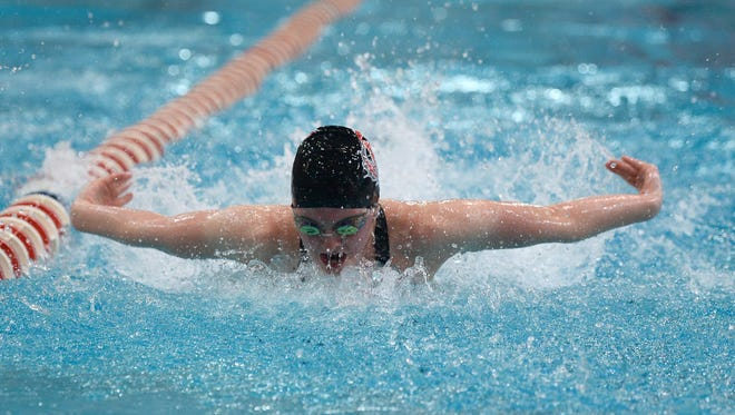 Elgin junior Madison Linstedt swims in the 100-yard butterfly during the Division II state swimming championships in Canton last month. Linstedt as named Fahey Bank Athlete of the Month for Marion County girls for February.