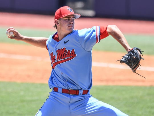 Mississippi pitcher James McArthur throws against Tennessee