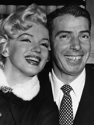 Joe DiMaggio and actress Marilyn Monroe smile cheek to cheek as they wait patiently in Judge Charles Perry's chambers for their marriage ceremony on Jan. 14, 1954.
