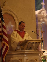 The Rev. Steven Hurley gives the homily during the annual Blue Mass in Wilmington, which honors public servants who died this past year and a half, on Friday.