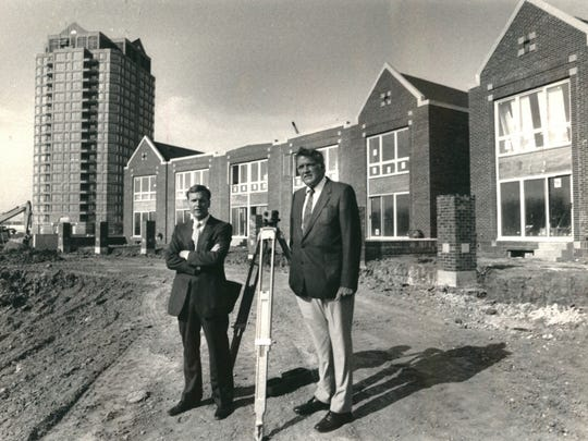 Larry Marantette, left, of ANR Development Corp., and Daniel Curran of Mich Con Development Corp., stand at Harbortown development on Detroit's east riverfront in the late 1980s.