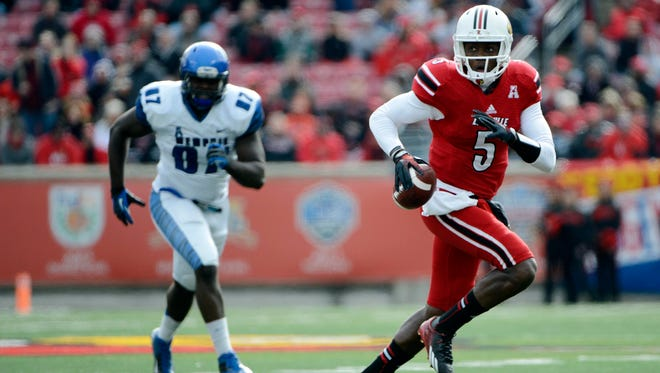 Louisville QB Teddy Bridgewater completed 26 of 36 passes for 220 yards and one touchdown in the Cardinals' 24-17 win over Memphis.