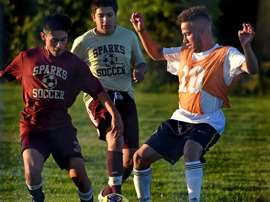 The Sparks varsity soccer team battles it out in a