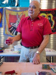Tom Craven shows off a sleight-of-hand magic trick Thursday as part of Colon's MagiCelebration.